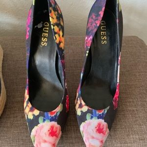 Guess flowers heels . Slightly used .